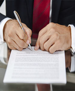 picture of person signing a form